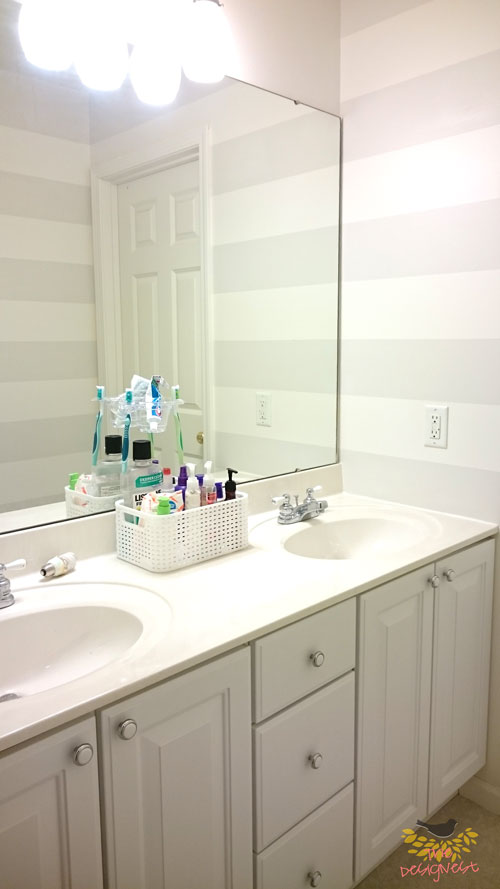 Bathroom Makeover | Adding horizontal stripes in a small bathroom makes the space feel more open.