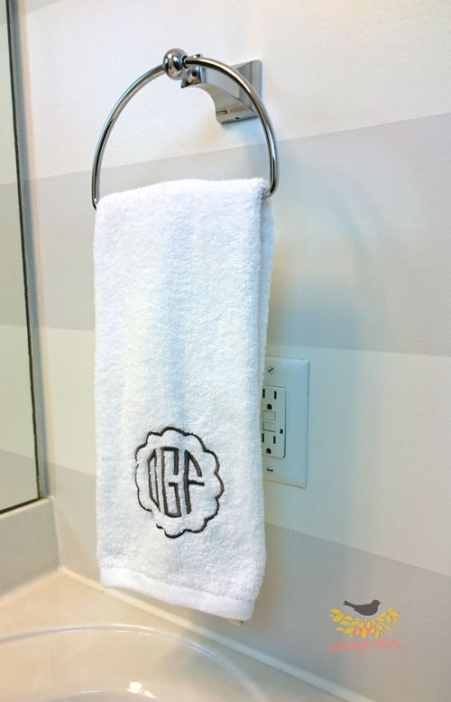 Bathroom Makeover | Embroidered Circle Monogram Hand Towels give it a personal touch.