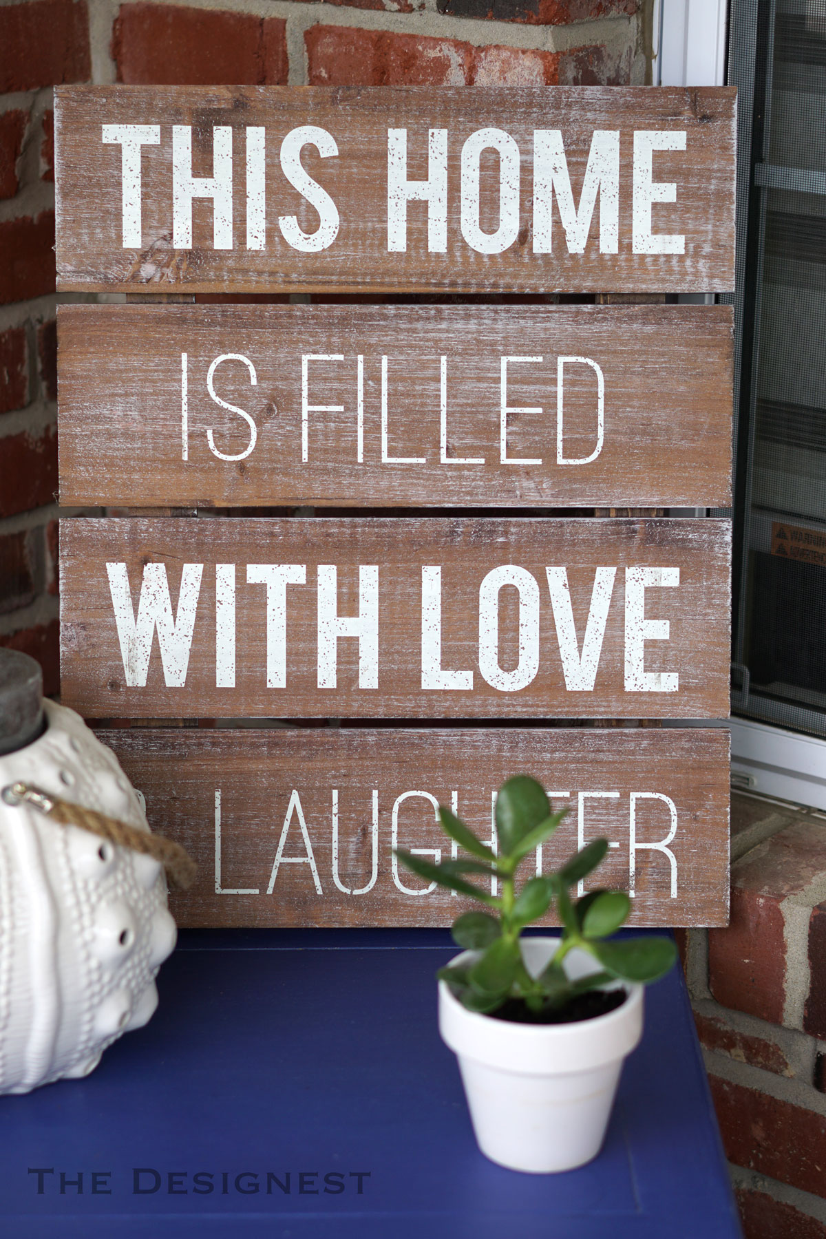 This home is filled with love & laughter sign.